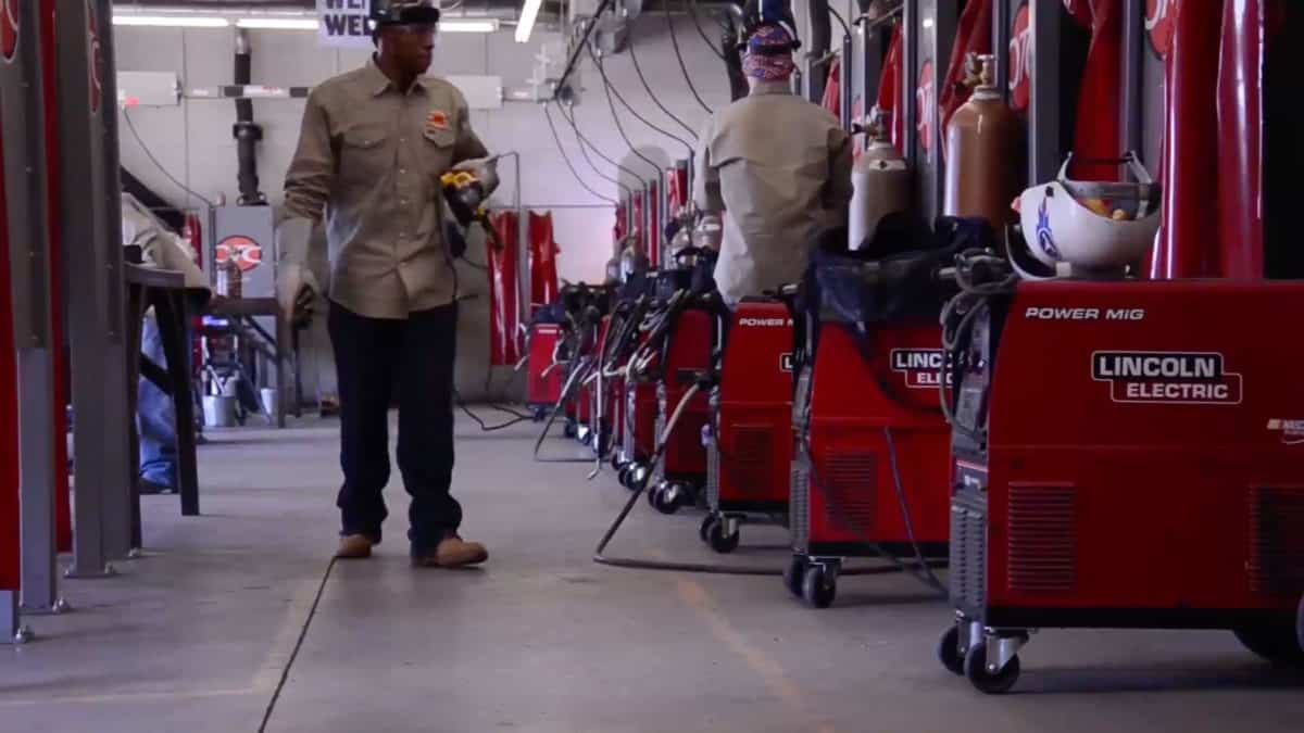 student walking in oklahoma technical college shop in tulsa ok