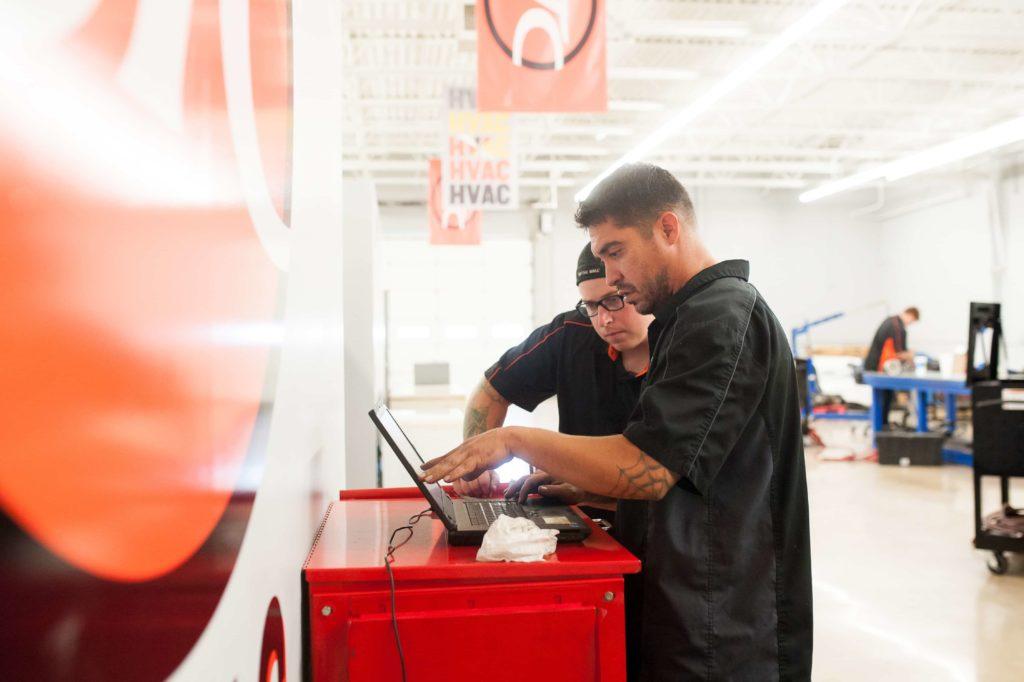 Diesel Mechanics looking at computer